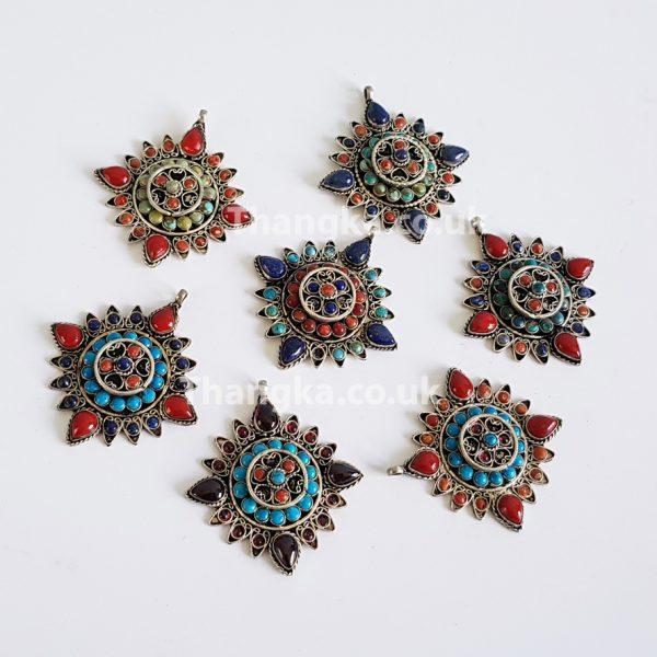 selection of tibetan turquoise and coral pendants