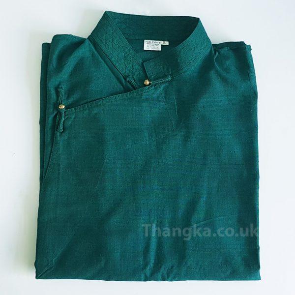 folded green tibetan shirt